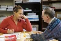 A teacher helping a student study