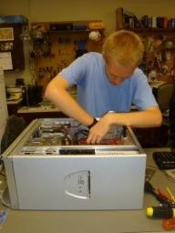 OAOC Info Tech Student working on a computer