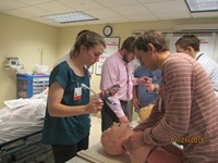 Medical students training on mannequins