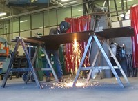 A student welding pieces of metal